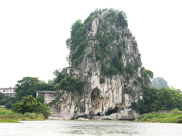 Fubo Hill standing ont the bank of Li River is a should-not-miss sight in Guilin