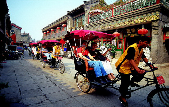 Taking a 3-wheel rickshaw to explore traditional Beijing hutong