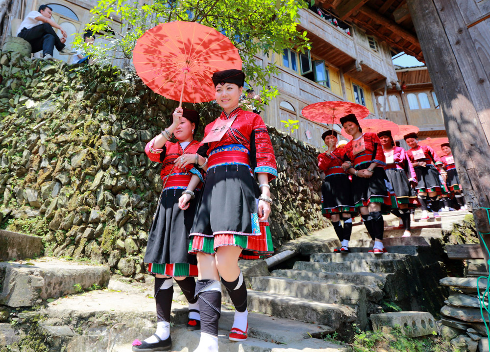 Yao girls wear red clothes in Dazhai Village