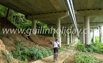 Exclusive Guilin Mountain Bike Tour, Cycling under the Motorway from Guilin to Xing'an