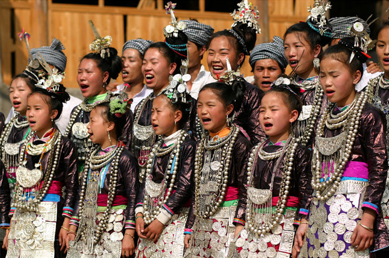 Miao people are performing the incredible Grand Song