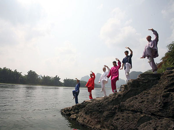 Join in the authentic Taiji lesson in Guilin riverside in the morning