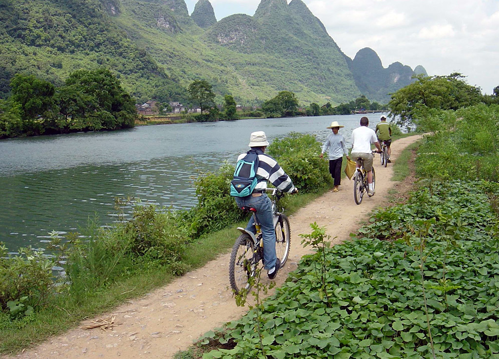 Bike riding into Yangshuo countryside for attractive rural scenery.