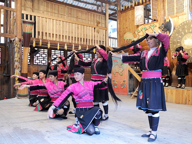 Yao women are performing a dancing show with their long hair