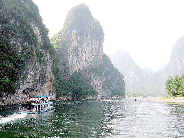 Take a Li River Cruise to admire the surreal Karst Landscape