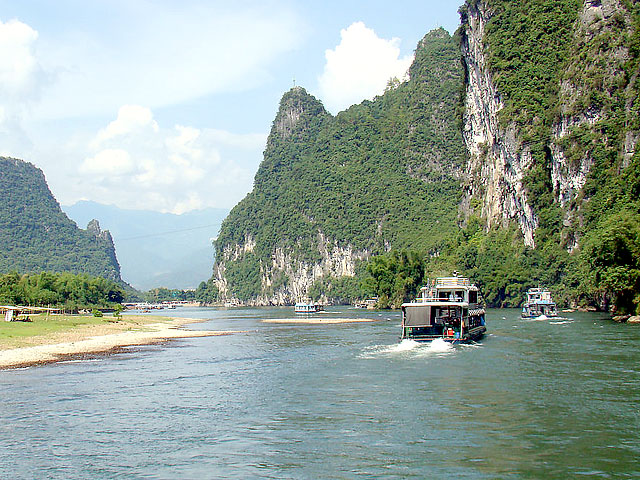 Take a Li River cruise for beautiful Karst peaks