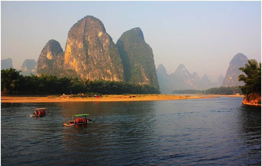 Take a bamboo rafting to tour the best part of Li River