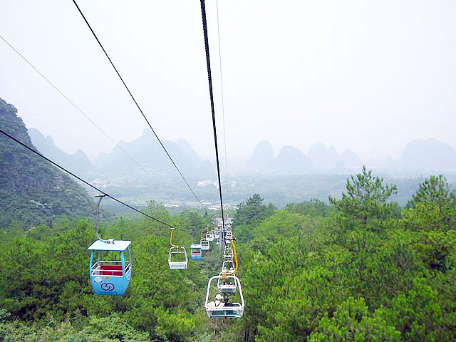 Take cable car to the top of Yao Mountain - the highest peak in Guilin