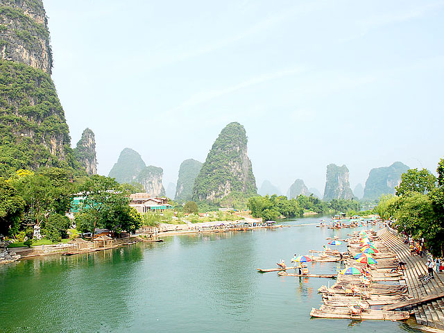 Leisurely bamboo rafting along Yangshuo Yulong River